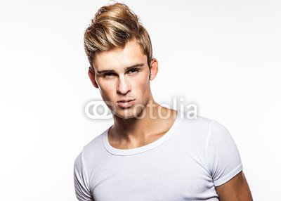 Elegant_young_handsome_man._Studio_fashion_portrait..jpg
