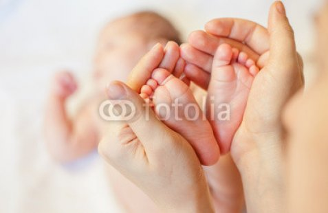 Mother-holding-baby-feet-at-hands.jpg