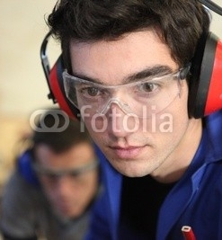 Closeup_of_a_young_worker_wearing_ear_defenders.jpg