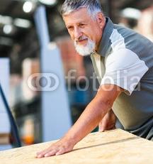 Senior_man_buying_construction_wood_in_a__DIY_store.jpg