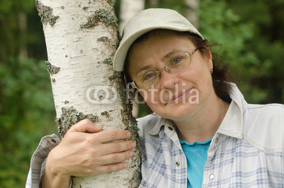 Portrait-of-a-woman-near-a-birch-forest.jpg