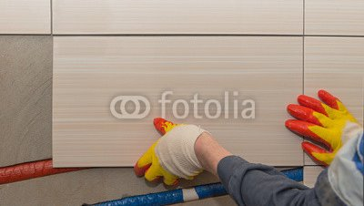 laying-tiles-on-the-wall.jpg
