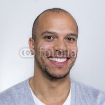 Portrait-of-a-man-in-a-tee-shirt-smiling-to-camera.jpg