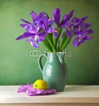 Beautiful_still_life_with_iris_flower_over_grunge_background.jpg