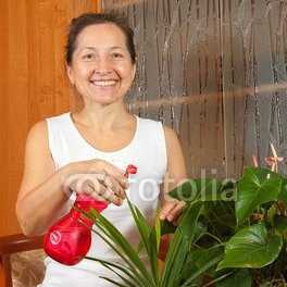 Mature_woman_potted_plants_sprinkles.jpg