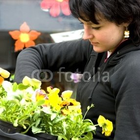 young_florist_with_spring_flowers.jpg