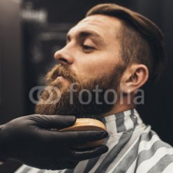 Hipster-young-good-looking-man-visiting-barber-shop.-Trendy-and-stylish-beard-styling-and-cut..jpg