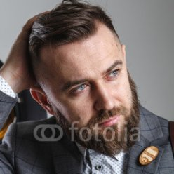 Portrait-of-a-stylish-man-with-a-beard-on-white-background.jpg