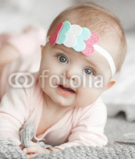 Cute-litttle-baby-at-home-in-the-bedroom.-An-infant-indoors.-6th-month-child-portrait.-Adorable-cute-baby-girl..jpg