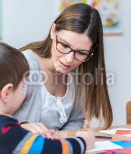 Kindergarten-Teacher-Supports-Child-on-Class.jpg