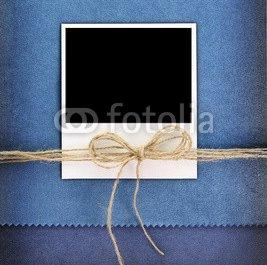 Polaroid_photo_frame_on_vintage_blue_background.jpg