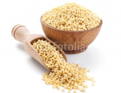 millet_in_a_wooden_bowl_isolated_on_white.jpg
