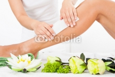 Beautician_Waxing_A_Womans_Leg.jpg