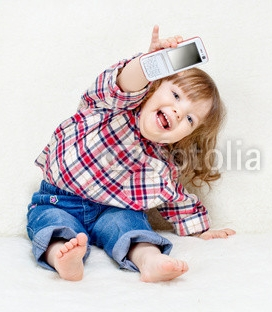beautiful_little_child_holds_a_cell_phone.jpg
