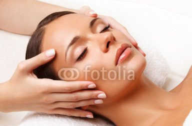 Face_Massage.__Close-up_of_a_Young_Woman_Getting_Spa_Treatment..jpg