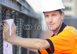 Construction_worker_working_at_a_building_site.jpg