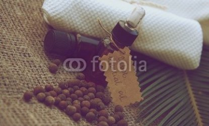A_bottle_of_cubeb_essential_oil_on_the_sackcloth._Vintage.jpg