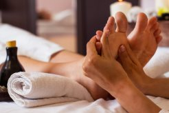 Massage-of-human-foot-in-spa-salon-Soft-focus.jpg
