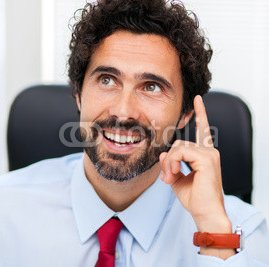 businessman_coming_up_with_an_idea_in_his_office.jpg