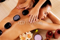 Adult_woman_having_hot_stone_massage_in_spa_salon.jpg