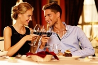Beautiful_young_couple_with_glasses_of_red_wine.jpg