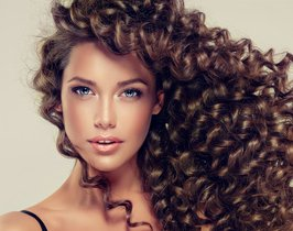 Brunette-girl-with-long-and-shiny-curly-hair-.-Beautiful-model-with-wavy-hairstyle-.-.jpg