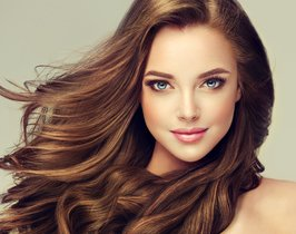 Brunette-girl-with-long-and-shiny-wavy-hair-.-Beautiful-model-with-curly-hairstyle-..jpg
