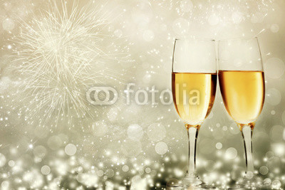 Glasses-with-champagne-against-fireworks.jpg