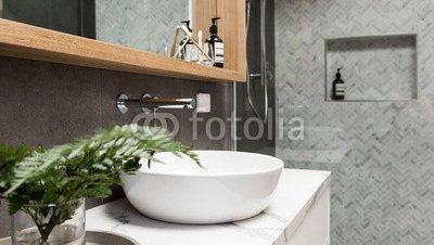 Bathroom-details-clean-white-basin-with-shower-tiling-behind.jpg