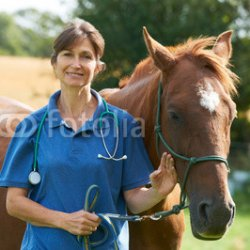 Portrait-Of-Female-Vet-In-Field-With-Horse.jpg
