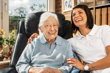 Nurse_caring_for_elderly_person.jpg