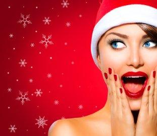 Christmas_Woman._Beauty_Model_Girl_in_Santa_Hat_over_Red_xs.jpg