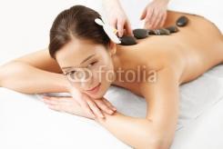 Stone_Massage._Beautiful_Woman_Getting_Spa_Hot_Stones_Massage.jpg