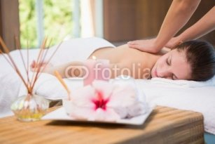 Attractive_woman_receiving_back_massage_at_spa_center.jpg